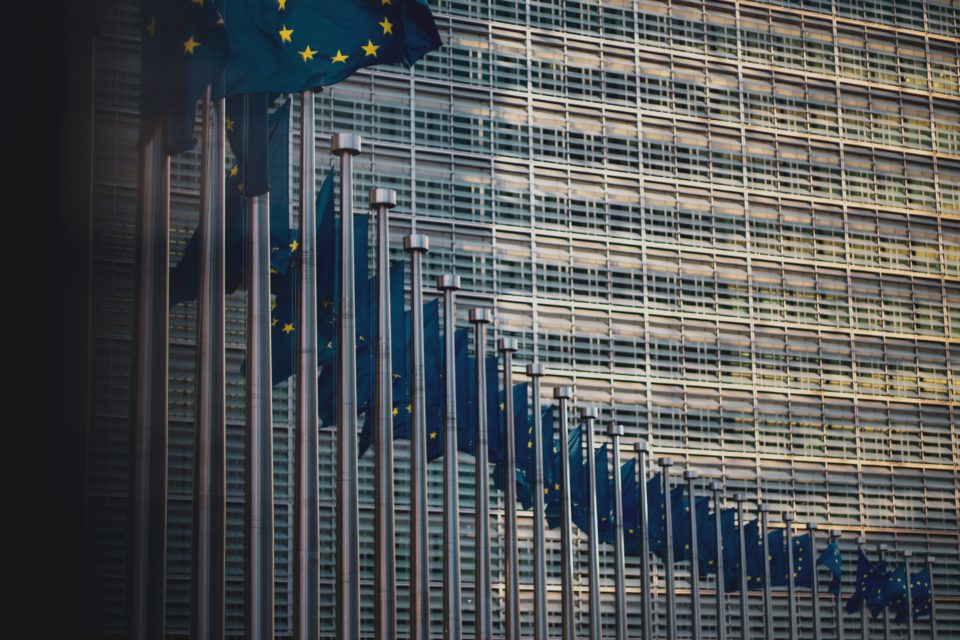 """Flags of the member states of the European Union in front of the EU-commission building """"Berlaymont"""" in Brussels, Belgium"""